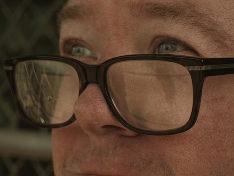 close-up on man wearing glasses with down syndrome